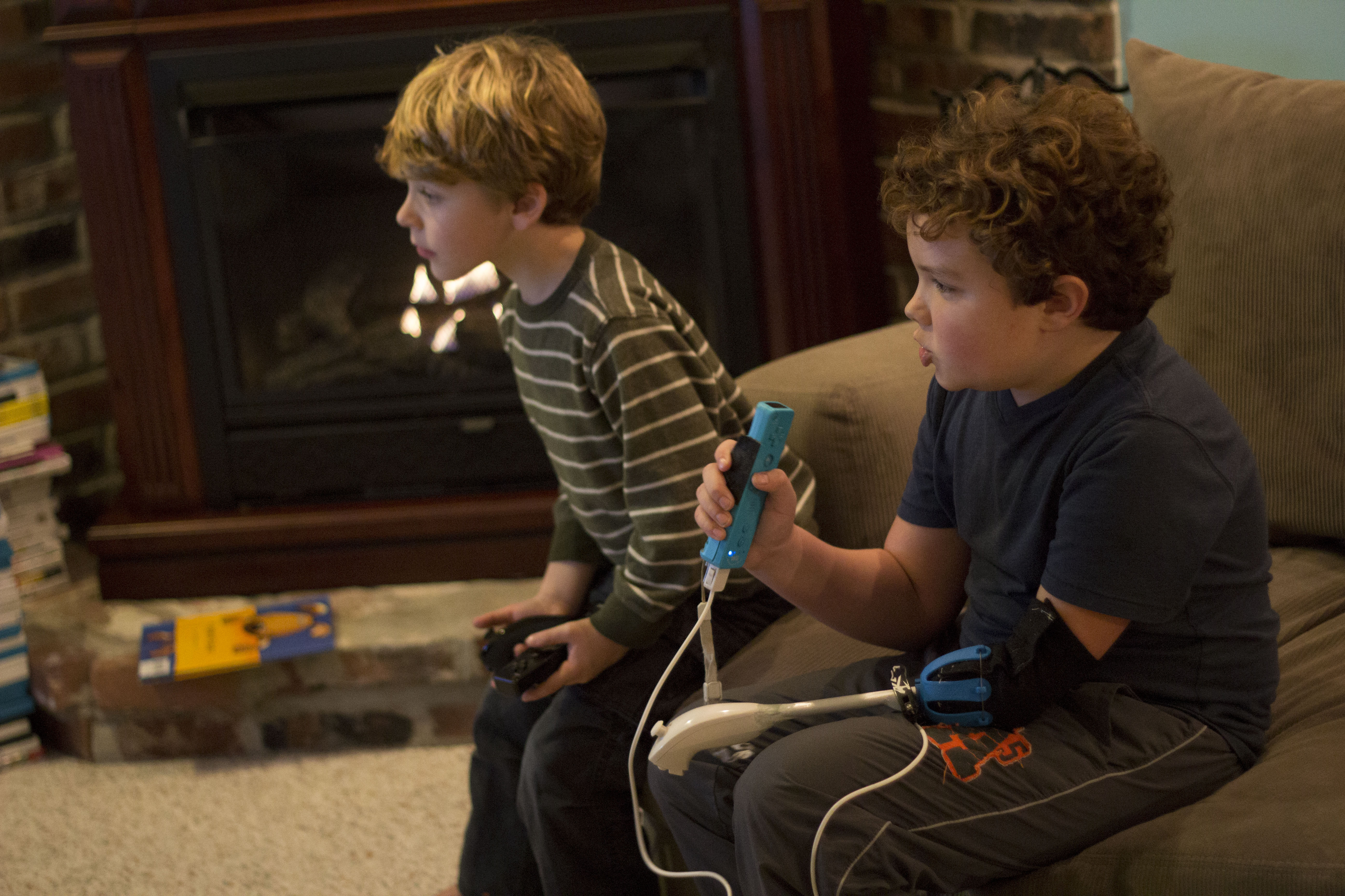 Aidan and his brother playing Wii together.