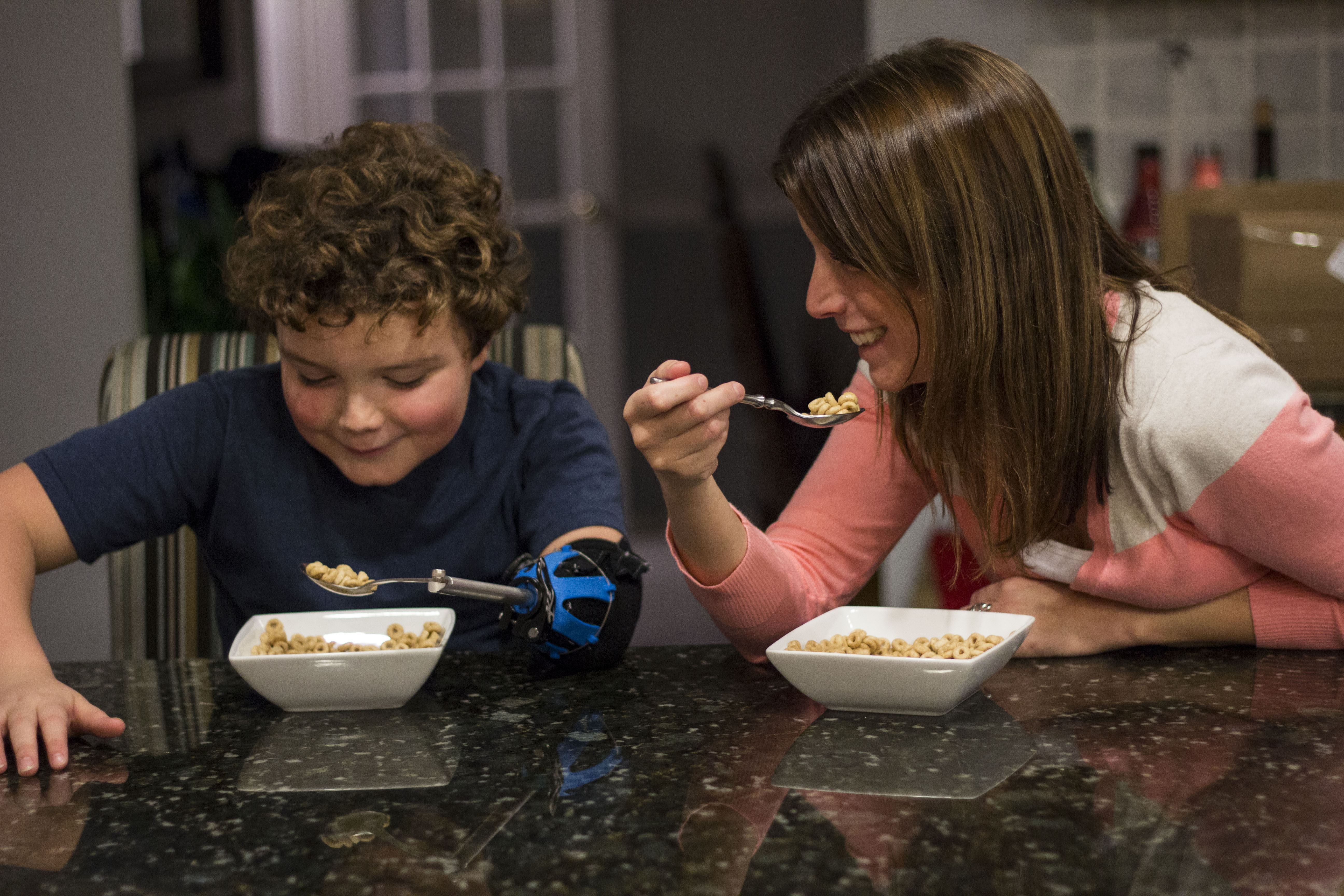 The spoon and fork attachments allow Aidan to eat more effectively.