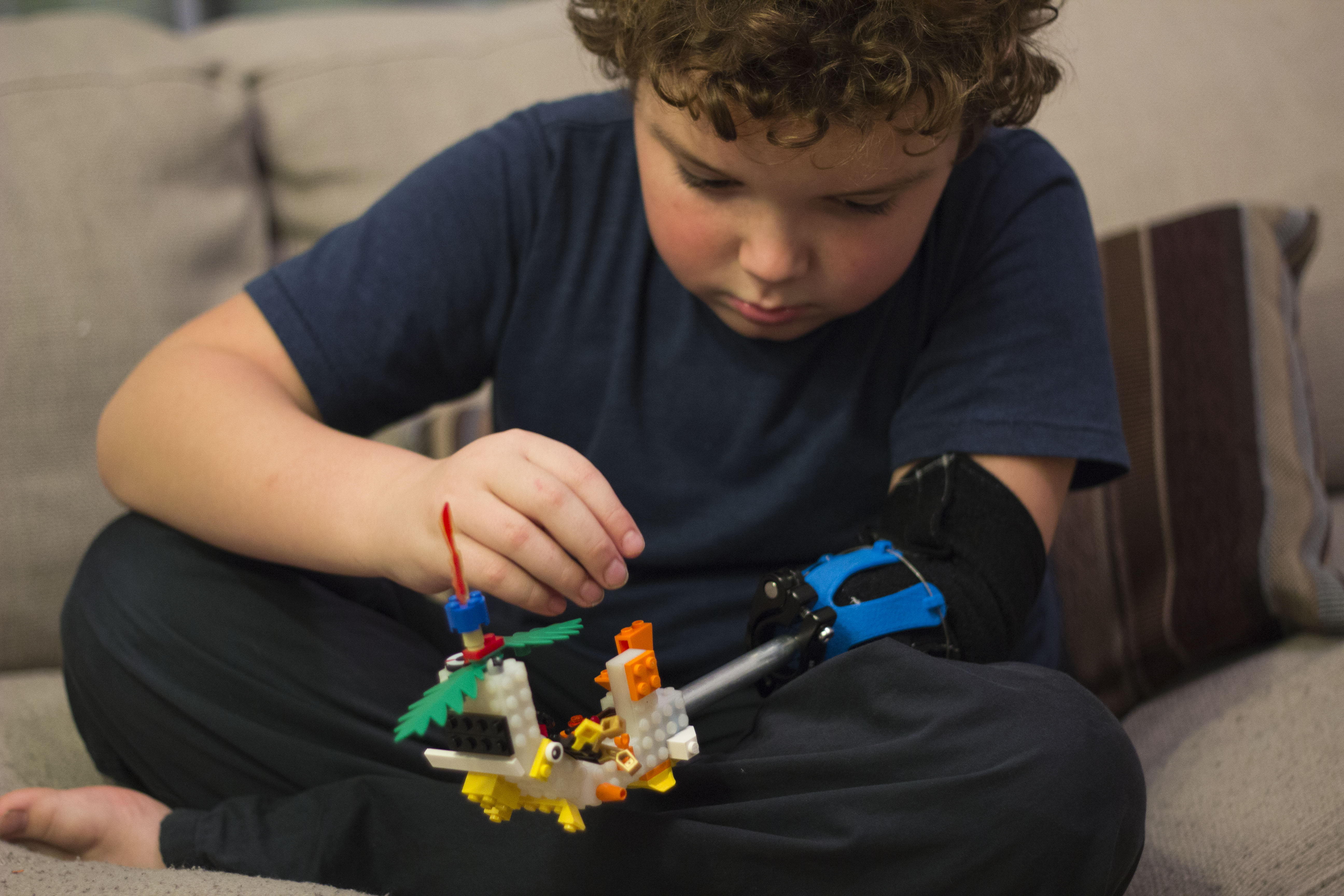 The LEGO attachment has two functions. First is purely as a building to for fun. More importantly it is a platform for him to prototype future arm attachments.