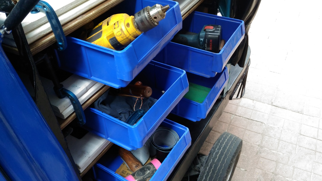 When the folding tables are stored in the auto, tools can be accessed like a chest of drawers.