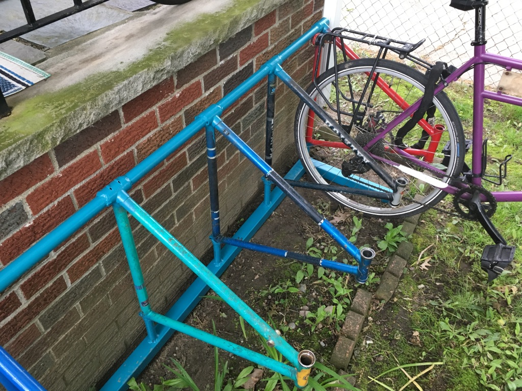I made this bike rack for my house out of old discarded bike frames.